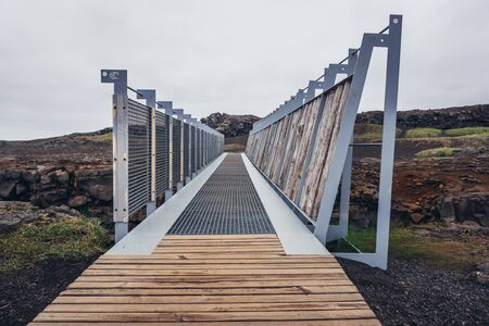 Midlina - the small symbolic footbridge between two continents in Reykjanes Peninsula in Iceland