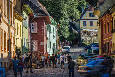 Sighisoara, Romania - July 4, 2016: Tourists on a School Street in historic part of Sighisoara city located in Mures County Editorial