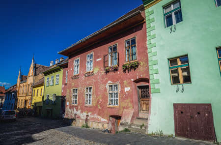 Sighisoara, Romania - July 4, 2016: Row of tenement houses on School Street in historic part of Sighisoara city located in Mures County Editorial