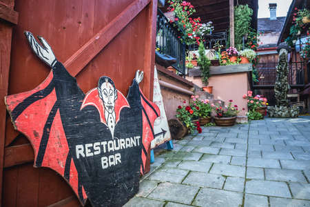 Sighisoara, Romania - July 4, 2016: Entrance to restaurant Casa Vlad Dracul in Old Town of Sighisoara