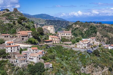 Aerial view with remains of Pentefur castle on hill in Savoca village on Sicily, Italy