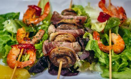 Shashliks in tapas bar in San Sebastian city in Basque County of Spain