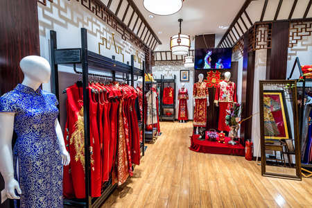 Beijing, China - February 8, 2019: Shop with traditional Chinese clothes in Qianmen shopping area in Beijing city Editorial