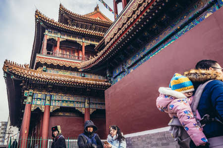 Beijing, China - February 7, 2019: Tourists in famous Palace of Peace and Harmony commonly called Lama temple in Beijing