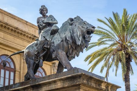 Statue of Melpomene - Muse of Tragedy in front of Teatro Massimo Vittorio Emanuele opera house in Palermo city, Sicily Island in Italy