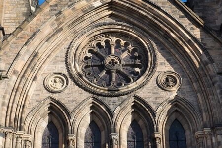 Rose window in frontage of St Mary Cathedral in Edinburgh city, Scotland, UK