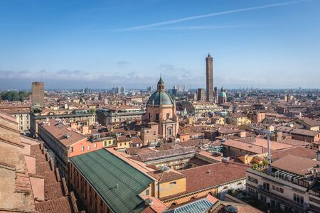Panorama of historic part of Bologna city, Italy - view from St Petronius Basilica with dome of Santa Maria della Vita church and Two Towers