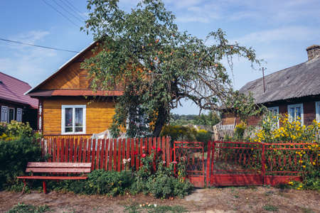 Wooden folk cottages in Soce, small village of so called Land of Open Shutters in Podlasie region of Poland Publikacyjne