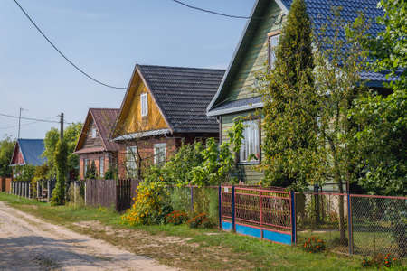 Row of traditional wooden folk cottages in Soce, small village of so called Land of Open Shutters in Podlasie region of Poland