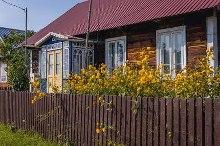 Wooden folk cottage in Soce, small village in Podlasie region of Poland