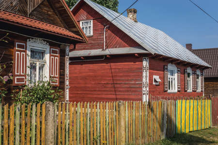 Traditional wooden folk cottages in Soce, small village in Podlasie region of Poland Publikacyjne