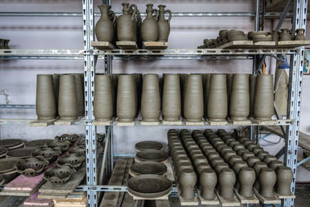 Marginea, Romania - July 13, 2019: Ceramic vessels in the Romanian village of Marginea, famous for the traditional production of black pottery