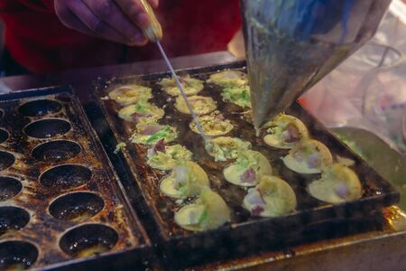 Dough balls stuffed with octopus in Nanluoguxiang hutong in Beijing city, China