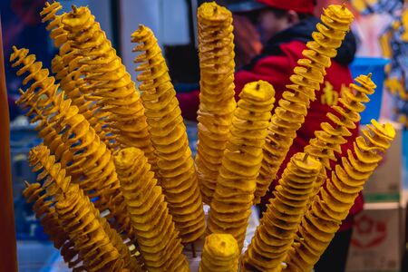 Tornado potatoes in street food bar in Nanluoguxiang hutong, Beijing city, China