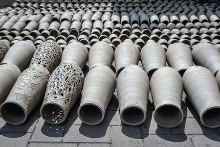Marginea, Romania - July 13, 2019: Drying ceramic vessels in Romanian village of Marginea, famous for the traditional handmade production of black pottery