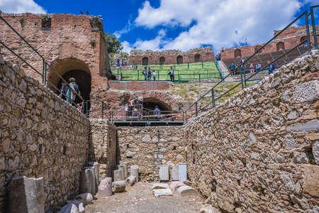 Taormina, Italy - May 5, 2019: Ruins of Greek Theatre in historic part of Taormina city on Sicily Island