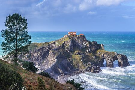 Gaztelugatxe isle with famous San Juan hermitage located on Bay of Biscay of the northeast Atlantic Ocean in Spain