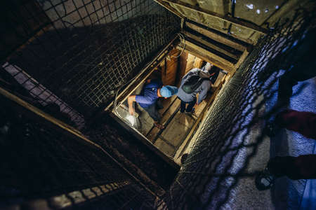 Sarajevo, Bosnia and Herzegovina - August 24, 2015. Tourists visits museum of underground tunnel constructed by Bosnian Army during the Siege of Sarajevo Editorial