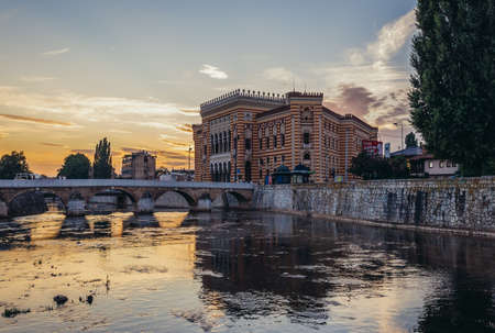 Sarajevo, Bosnia and Herzegovina - August 24, 2015. Sarajevo City Hall building commonly known as Vijecnica completed in 1896, lecated on the bank of Miljacka River