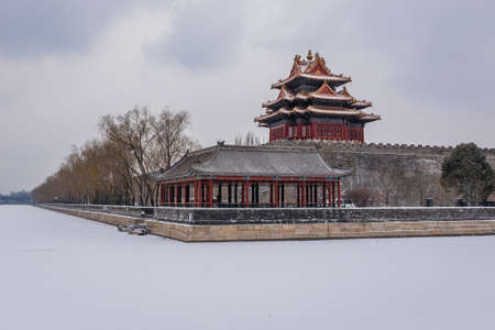 Moat and one of corners tower of Forbidden City, main tourist attraction in Beijing, capital city of China Editorial