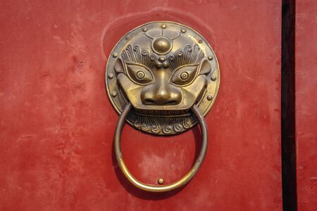 Details of traditional Chinese door in Jingshan Park, former private imperial park in Beijing, capital city of China