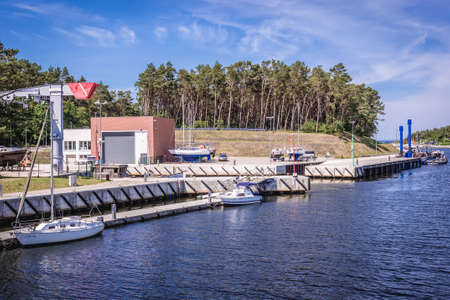 Mrzezyno, Poland - June 25, 2019: Repair dock on River Rega estuary in Mrzezyno town on the Baltic Sea coast Publikacyjne
