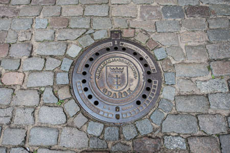 Gdansk, Poland - 17th October 2014: manhole cover at Mariacka Street, most famous street in Main Town of Gdansk