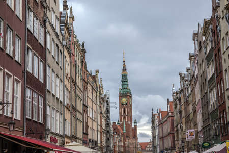 Gdansk, Poland - 17th October 2014: Row of restaurants with Main Town Hall tower in Old Town of Gdansk Redactioneel