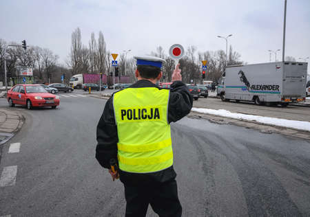Warsaw, Poland - March 17, 2010: Traffic police stopping car on the street in Warsaw city