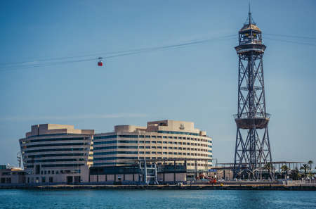 Barcelona, Spain - May 26, 2015. View of World Trade Center Barcelona building and Torre Jaume I tower of Port Vell Aerial Tramway