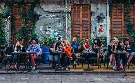 Tel Aviv, Israel - October 20, 2015. People sits at tables outside the restaurant at Rothschild Boulevard in Tel Aviv Editorial
