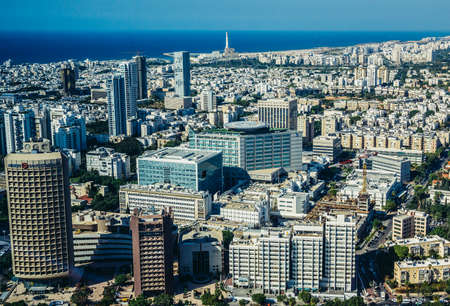 Tel Aviv, Israel - October 21, 2015. Aerial view from 49th floor of Circular Tower, one of three skyscrapers of Azrieli Center complex in Tel Aviv. Sourasky Medical Center in the center of the image