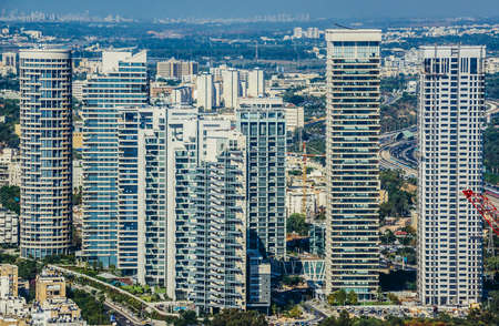 Tel Aviv, Israel - October 21, 2015. Aerial view from 49th floor of Circular Tower, one of three skyscrapers of Azrieli Center complex in Tel Aviv. Residential buildings of Park Tzameret on photo