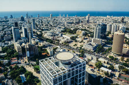 Tel Aviv, Israel - October 21, 2015. Aerial view from 49th floor of Circular Tower, one of three skyscrapers of Azrieli Center complex in Tel Aviv. Matcal Tower on foreground