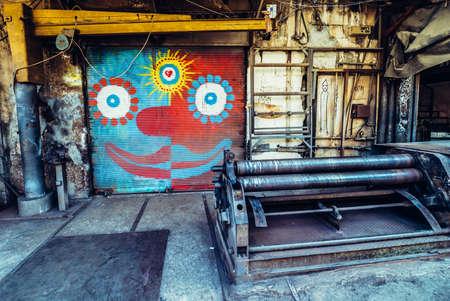 TEL AVIV, ISRAEL - OCTOBER 21, 2015. Graffiti on the roller shutter of small workshop in Florentin district of Tel Aviv