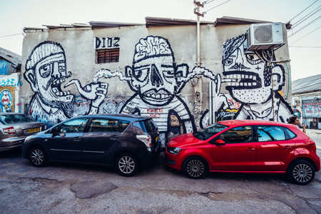 Tel Aviv, Israel - October 21, 2015. Graffiti tagged by artis Dioz in Florentin district of Tel Aviv Editorial