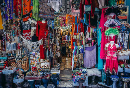 Jerusalem, Israel - October 22, 2015. Clothes, scarfs and souvenirs for sale on Arab baazar located inside the walls of the Old City of Jerusalem