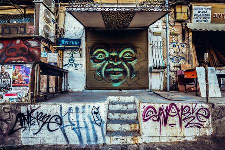 TEL AVIV, ISRAEL - OCTOBER 21, 2015. graffiti street art on the roller shutter of small workshop in Florentin district of Tel Aviv