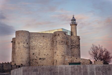 Santa Ana fortress and lighthouse in Castro Urdiales city in Spain Foto de archivo