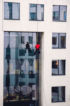 Warsaw, Poland - November 29, 2006: Window cleaner during cleaning of office building in Warsaw city