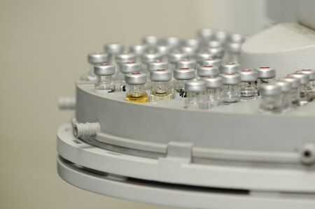 Chemistry lab - small vials in Gas Chromatograph autosampler
