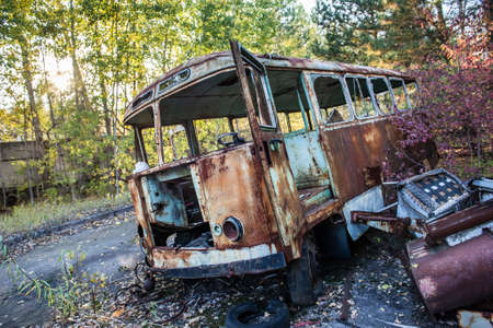 rusty bus in Jupiter Factory in Pripyat ghost town, Chernobyl Nuclear Power Plant Zone of Alienation, Ukraine Stock Photo