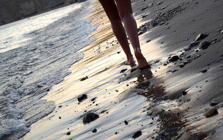 Woman walking on a beach at Red Sea coast in Egypt 免版税图像