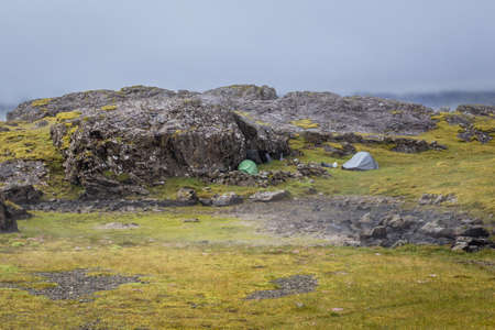 Wild camping in Iceland, two tents on a meadow in southeastern part of the country