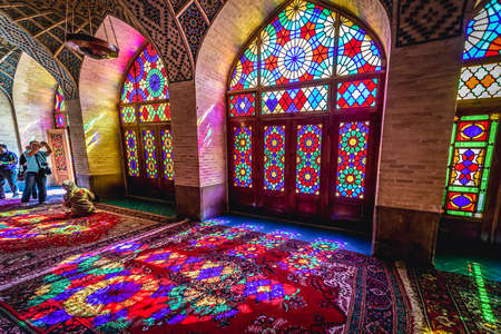 Shiraz, Iran - October 23, 2016: Tourists in Nasir ol Molk Mosque also known as Pink Mosque, one of the most famous mosques in Shiraz
