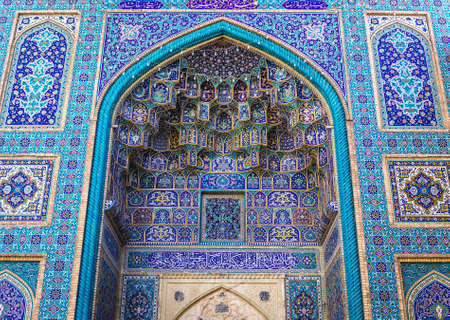 Shiraz, Iran - October 23, 2016: Details of Persian architecture of Shah Cheragh funerary monument and mosque in Shiraz