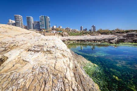 Modern buildings on the Mediterranean coast in Beirut, capital city of Lebanon, view from area next to famous Raouche Rocks