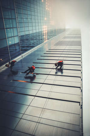 Warsaw, Poland - November 28, 2006: Window cleaners on a Rondo 1 office skyscraper located at Rondo ONZ in Warsaw city, capital of Poland 報道画像