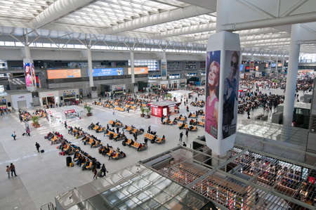 Shanghai, China - March 25th, 2013: crowd of passengers on one of the four major railway stations in Shanghai - Shanghai Hongqiao Railway Station