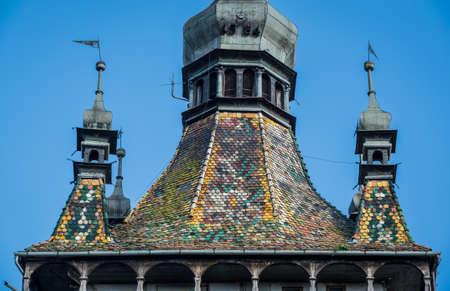Roof of Famous Clock Tower in Sighisoara town in Romania Foto de archivo